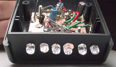 fun with ledsthe holes for the leds were bored with a hand drill and it shows! the discrete transistor multivibrator can be seen behind the 4017 ic